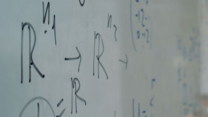 Whiteboard with mathematical formulae